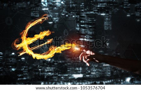 Fire glowing euro sign on night city background #1053576704