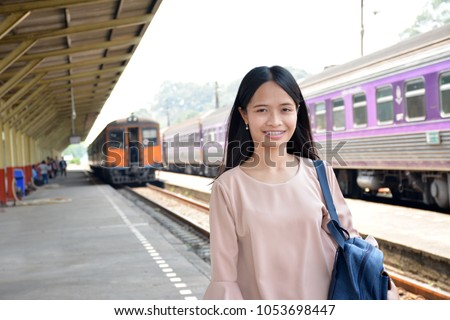 Asian woman  train station background #1053698447