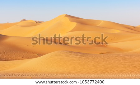 A dune landscape in the Rub al Khali or Empty Quarter. Straddling Oman, Saudi Arabia, the UAE and Yemen, this is the largest sand desert in the world. #1053772400