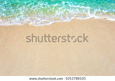 The background of sand with water splash into summer with space for text. #1053788105