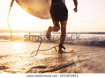 Man surfer run in ocean with surfboard. Active vacation, health lifestyle and sport concept image Royalty-Free Stock Photo #1053892841
