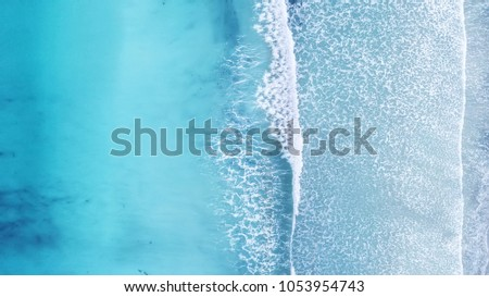 Wave on the beach as a background. Beautiful natural background at the summer time #1053954743