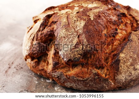 bread on board from above. Kitchen or bakery poster design. Freshley baked #1053996155