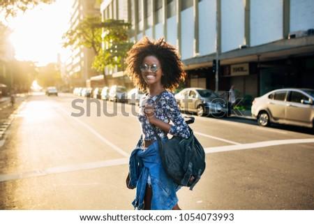 Young beautiful Brazilian girl walking alone the streets in Rio de Janeiro