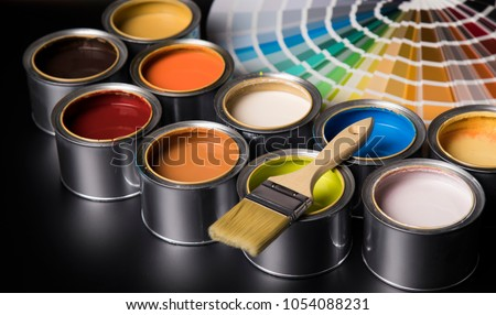 Paint can and paintbrush Royalty-Free Stock Photo #1054088231