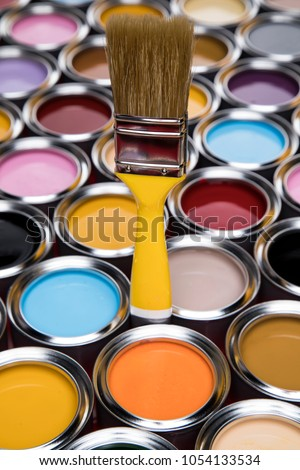 Tin metal cans with color paint and paintbrush #1054133534