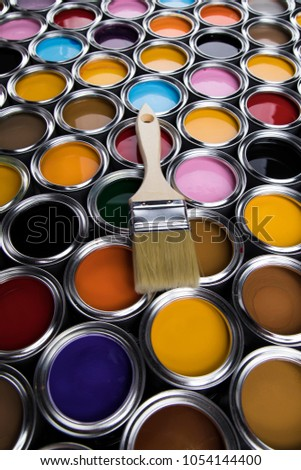 Tin cans with paint, brushes and bright palette of colors #1054144400