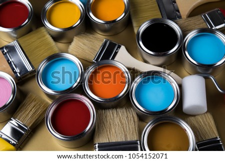 Metal tin cans with color paint and paintbrush #1054152071
