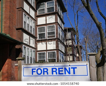 apartment building with for rent sign #1054158740