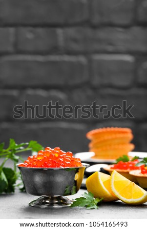 Red salmon fish caviar, salmon caviar in metal bowl. Caviar. Selective focus #1054165493