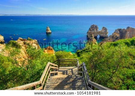 Wooden walkway to secret beach near Lagos on Ponta da Piedade. algarve region, Portugal #1054181981