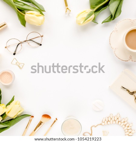 Female workspace with yellow tulip flowers, women's fashion golden accessories, diary,  glasses on white background. Flat lay. Top view feminine background. #1054219223