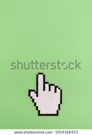 Link click pixel hand cursor symbol on green background with copy space #1054366955