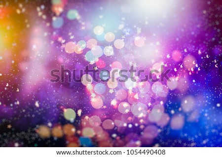abstract blurred of blue and silver glittering shine bulbs lights background:blur of Christmas wallpaper decorations concept.xmas holiday festival backdrop:sparkle circle lit celebrations display #1054490408