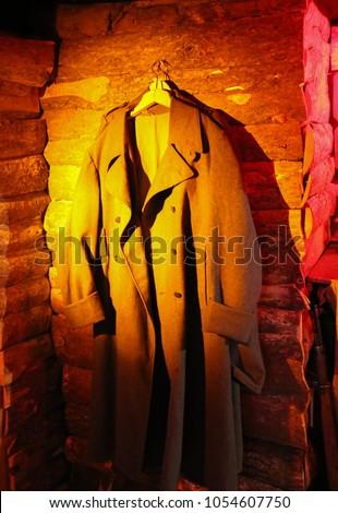 old coat on a hanger #1054607750
