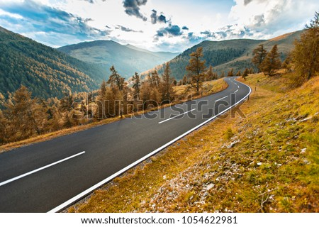 Asphalt road in Austria, Alps in a beautiful summer day, Nockalmstrasse. #1054622981
