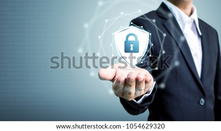 Protection network security computer and safe your data concept, Businessman holding shield protect icon #1054629320