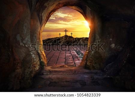 Empty tomb with three crosses  Royalty-Free Stock Photo #1054823339