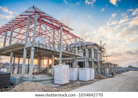 construction residential new house in progress at building site #1054842770