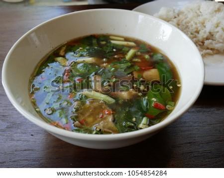 eat soup of thai food  #1054854284