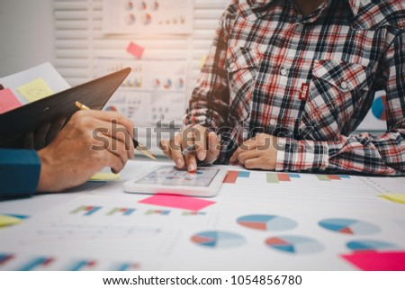 Business team financial inspector and secretary making report,tax,calculating or checking balance, Audit concept at working with plan and analyzing investment charts at workplace. #1054856780