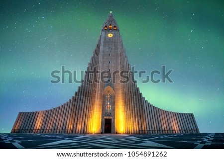Hallgrímskirkja is a Lutheran (Church of Iceland) church in Reykjavík.It is the largest church in Iceland and the tallest structures in Iceland.There is an colorful aurora borealis in baackground #1054891262