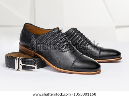 Men's leather shoes and belt on a white background Royalty-Free Stock Photo #1055081168