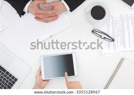 Two business people at office top view woman browsing digital tablet #1055128967