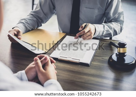 Customer service good cooperation, Consultation between a Businessman and Male lawyer or judge consult having team meeting with client, Law and Legal services concept. #1055242673