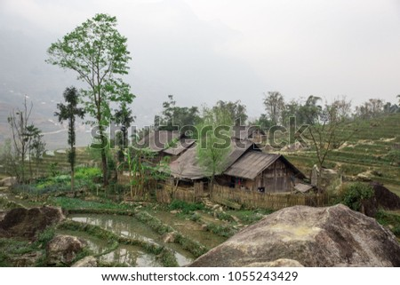 Old farm house surrounded by rice terraces in Sapa, Vietnam #1055243429