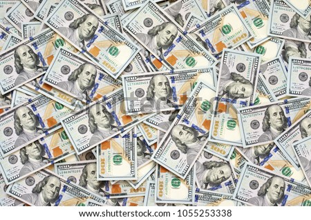 Pile of new design US dollar bills as background. Top view point.