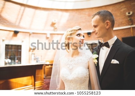 Perfect couple bride, groom posing and kissing in their wedding day #1055258123