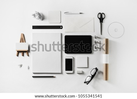 Photo of blank corporate stationery and gadgets set on white paper background. Flat lay. #1055341541
