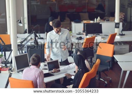 startup business people group working everyday job at modern office #1055364233