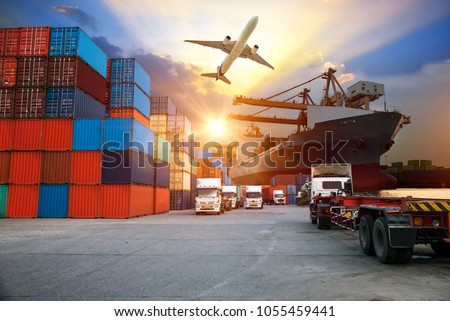 Container ship in import export and business logistic. Trade Port. Shipping, cargo to harbor and Cargo plane with working crane bridge in shipyard , logistic import export and transport industry  #1055459441