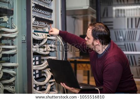 Engineer working in server room #1055516810
