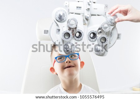 Child with down syndrome. Eye vision therapy. #1055576495