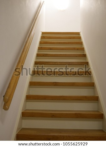 Wooden stairs in white hall #1055625929