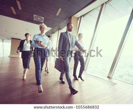 business team, businesspeople  group walking at modern bright office interior #1055686832
