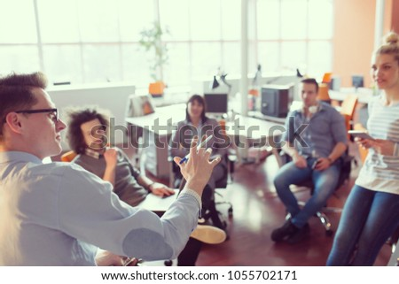 Group of a young business people discussing business plan  in the office #1055702171