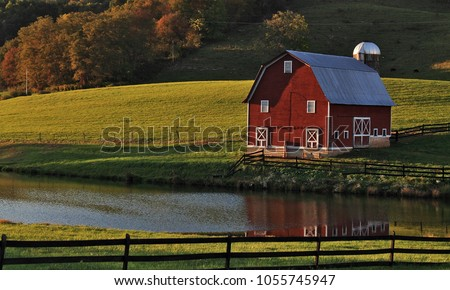 Fall reflections - picturesque red barn in southern West Virginia