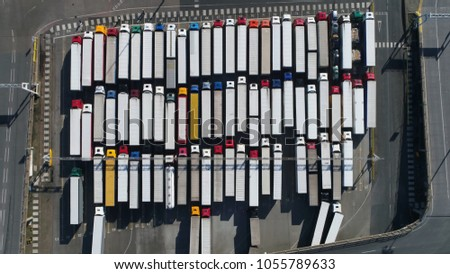 Aerial top down photo of harbor and trucks parked along side each other getting ready for embarking the Dover Ferry to Calais #1055789633