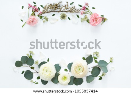 Frame wreath with white ranunculus flowers on white background. Flat lay, top view. #1055837414