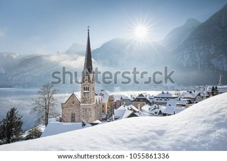 Panoramic view of famous Hallstatt lakeside town during winter sunrise on a beautiful cold sunny day at Christmas time, Salzkammergut, Austria #1055861336