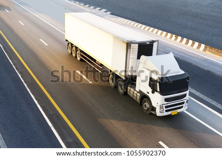 White Truck on highway road with container, transportation concept.,import,export logistic industrial Transporting Land transport on the expressway.motion blurred to soft focus #1055902370