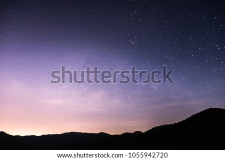 Mountains at night have the Milky Way and stars shine in the dark sky. #1055942720