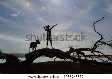 Morning Silhouette with child and dog