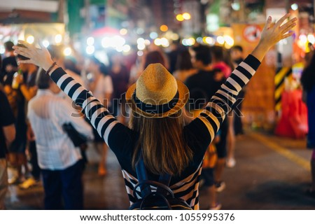 Young asian woman traveler backpacker with hat and bag traveling to Chiang Mai night walk street market at Chiang Mai Province, Thailand. #1055995376