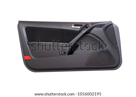 Isolated modern sports car door panel with red reflector, black fabric insert, pleather armrest, carbon fiber grip, door lock opening switches, window rocker buttons, mirror switch and chrome handle. #1056002195