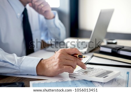 Business Financing Accounting Banking Concept, businessman doing finances and calculate about cost to real estate investment and in other, tax system. #1056013451